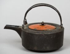 A 19th century Japanese cast iron tea kettle With a loop handle,