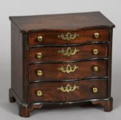 A 19th century mahogany miniature serpentine chest of drawers With four graduated serpentine