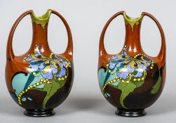 A pair of early 20th century Dutch vases by Arnhemse Fayencefabriek Each with twin loop handles and