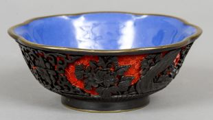 A Chinese red and black cinnabar lacquered bowl Worked with floral sprays and lotus strapwork,