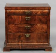 A 19th century Biedermeier style mahogany chest of drawers The canted rectangular top above a