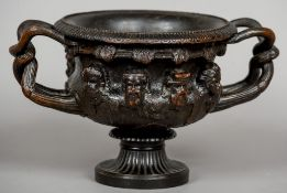 After the Antique, a 19th century bronze model of the Albani vase Typically worked.  18 cm high.