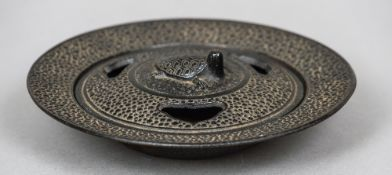 A 19th century Japanese cast iron censor and cover The pierced removable lid with a turtle form