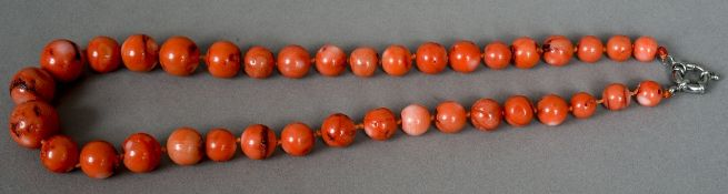 A string of coral beads Of varying sizes.  52 cm long.