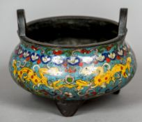 A Chinese bronze and enamel twin handled censor Decorated with stylised dragons amongst lotus
