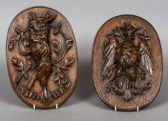 Two late 19th century carved oak panels Each carved with a game trophy, one a bird,