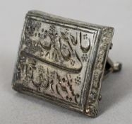 An Eastern white metal seal, possibly Persian