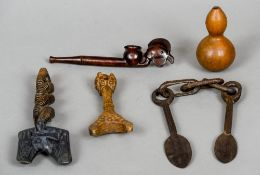 Six various treen artefacts, mostly African Including: a Southern African pipe,