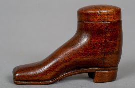 A carved wood shoe snuff box and cover Of typical form.  5.5 cm high.