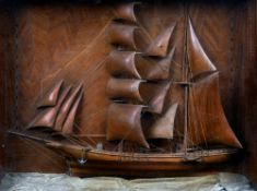A 19th century diorama Worked as a Brigantine in full sail, glazed and the frame inlaid.  57 x 47.