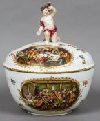 A Berlin porcelain tureen and cover With bacchic putto finial and decorated with Hogarthian scenes