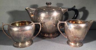 An Art Deco Indian silver three piece tea set, hallmarked for Delhi, maker's mark of Warner Bros.