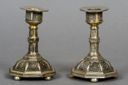 A pair of Erhard & Sons dwarf candlesticks Each worked with filigree panels,