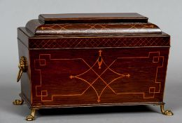 A 19th century inlaid mahogany tea caddy Of sarcophagus form,