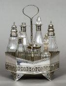 A George III seven bottle silver cruet stand and cruets, hallmarked London 1792,