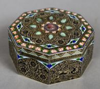 A 19th century Indian finely engraved and enamelled octagonal box The hinged lid with foliate