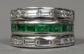 A contemporary 18 ct white gold diamond and emerald ring Set with twelve baguette cut diamonds and