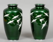 A pair of 20th century Japanese cloisonne vases Each decorated with cranes in flight,