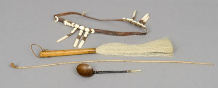 A group of ethnographic pieces  Comprising: an Aboriginal woomera (spear-thrower), a fly whisk,