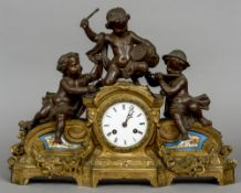 A bronzed art metal Sevres type porcelain inset mantel clock The 3 1/2 inch white enamel dial with