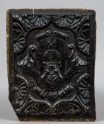 A carved oak panel, possibly Elizabethan