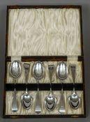 A set of six silver dessert spoons, hallmarked London 1843,