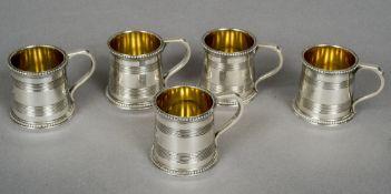 A set of five unusual Victorian silver miniature tankards, hallmarked London 1872,
