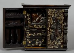 A 19th century Indo-Portuguese ivory inlaid coromandel table cabinet The twin florally inlaid and