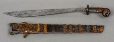 A finely carved South East Asian sword, possibly Dayak,