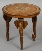 An early 20th century Anglo-Indian bone inlaid side table Of circular form with elephant mask