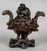 A Chinese carved soapstone censor Carved throughout with dogs-of-fo and mythical beasts.