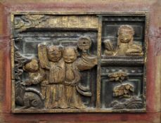 A Chinese carved wood panel Worked with figures with gilt highlights, framed.  43 x 34.5 cm.