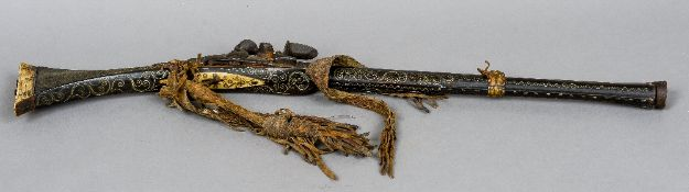 A North African flintlock rifle With bellied barrel and profuse white metal inlay.  93 cm long.
