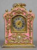 A pink enamel decorated unmarked silver gilt desk clock The domed top surmounted with a tiger.  9.