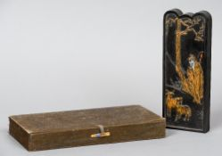 A cased Chinese ink block Decorated to one side with a sagely figure and goats,