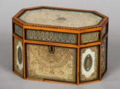 An early 19th century rolled paper tea caddy Of chamfered rectangular design with glass fronted