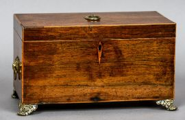 A 19th century rosewood caddy Standing on gilt cast bracket feet, the interior previously fitted.