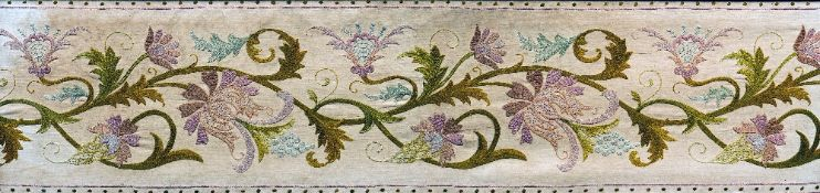 A 19th century needlework panel Worked with flowering acanthus scrolls, framed and glazed.