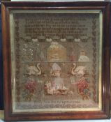 A 19th century needlework sampler by Emily Jane Brookes Worked with a religious verse above figures