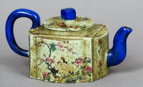 A Chinese terracotta teapot and cover With printed floral decoration, impressed seal mark to base.