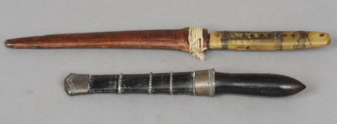 A 19th century white metal mounted ebony handled dagger and sheath Together with another,