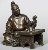 A Meiji period Japanese patinated bronze figure Formed as a seated artist carving a figure.