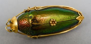 A Chinese high carat gold mounted beetle brooch