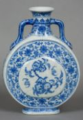 A Chinese blue and white porcelain twin handled moon flask Decorated with peach vignettes within a
