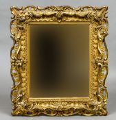 An 18th/19th century carved giltwood picture frame, converted to a wall glass 90 x 80 cm overall.