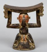An African tribal carved wooden head rest Formed as a figure.  18.5 cm high.