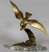 An Art Deco style Continental bronze sea bird Naturalistically modelled riding the crest of a wave,