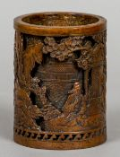 A Chinese double skin cast bronze brush pot Worked with figures playing Go and other figures in a
