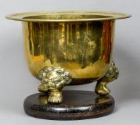 A 19th century Chinese bronze brazier The flared rim above the plain body and dog-of-fo mask headed