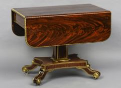 A Regency mahogany gilt decorated pedestal Pembroke table The rounded rectangular twin flap top